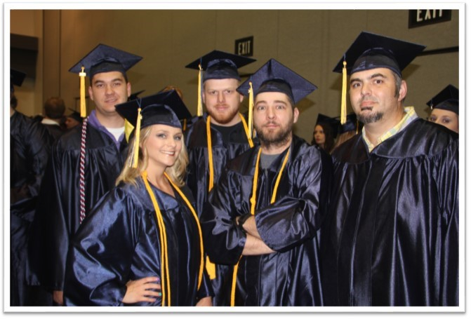 group of graduates smiling in the line up at graduation