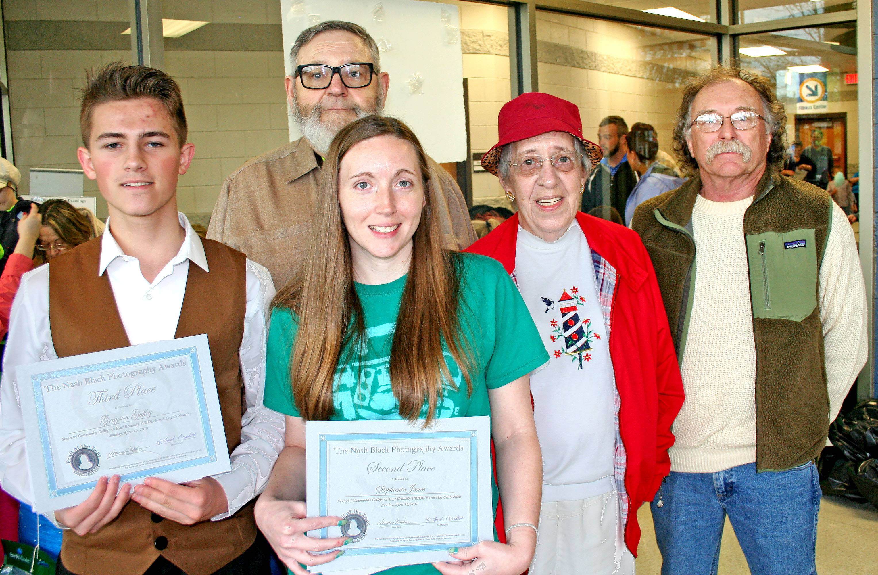 a photo of all five winners displaying their awrds at the Earth Day Celebration at SCC
