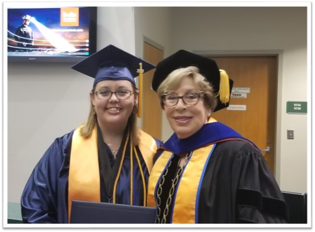 student government association president and president dr. jo marshall pose together before commencement