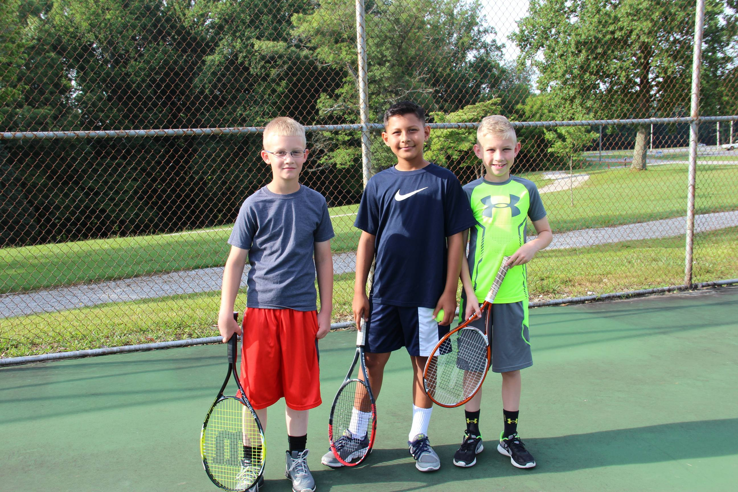 group of boys on tennis field