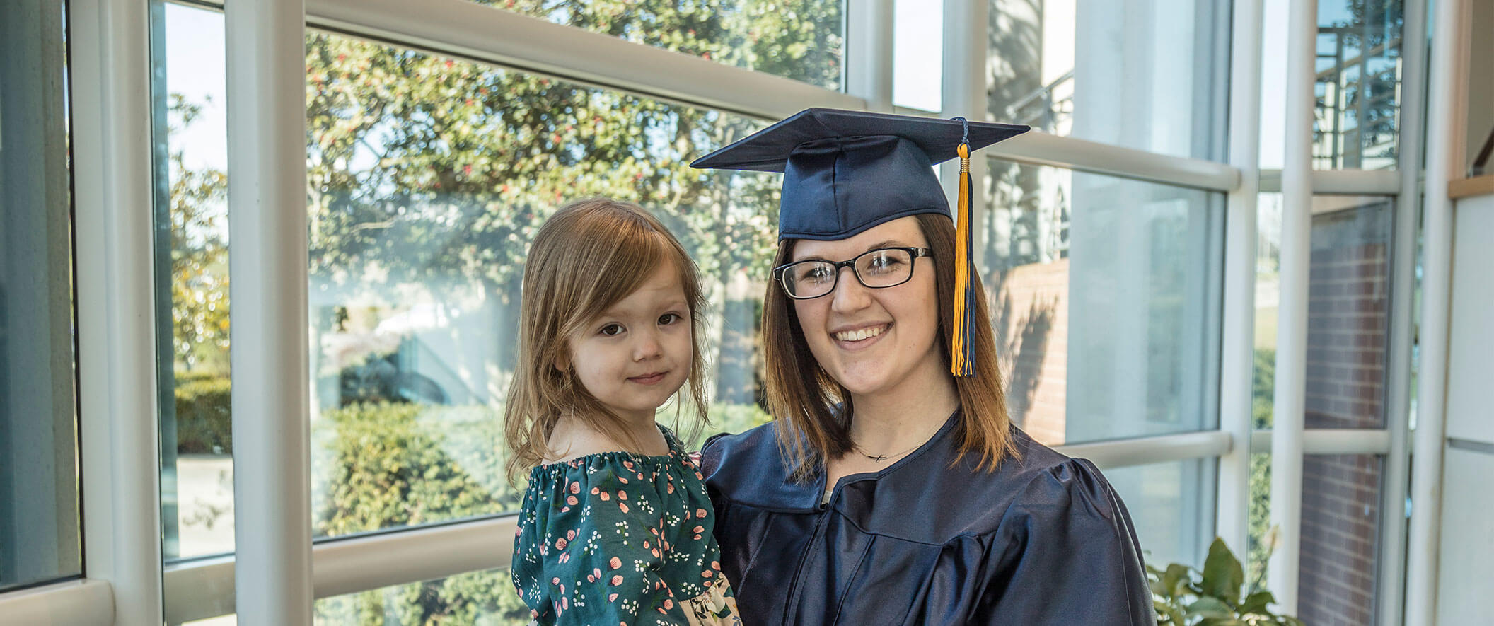 woman graduate with daughter