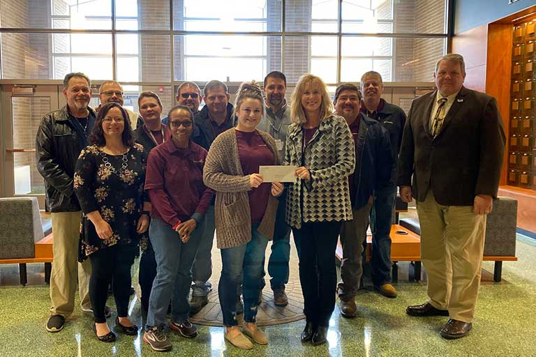 american woodmark group presenting donated funds to the college