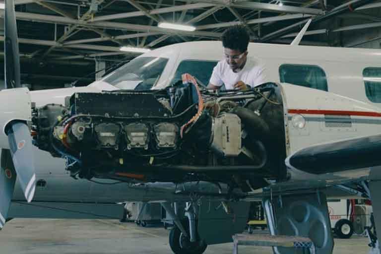 Aviation Maintenance Student working on airplane