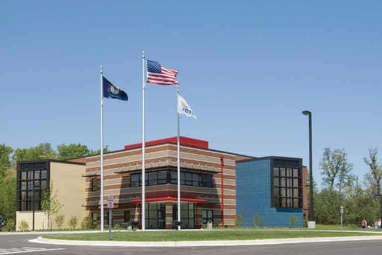 photo of mccreary center with two flag poles