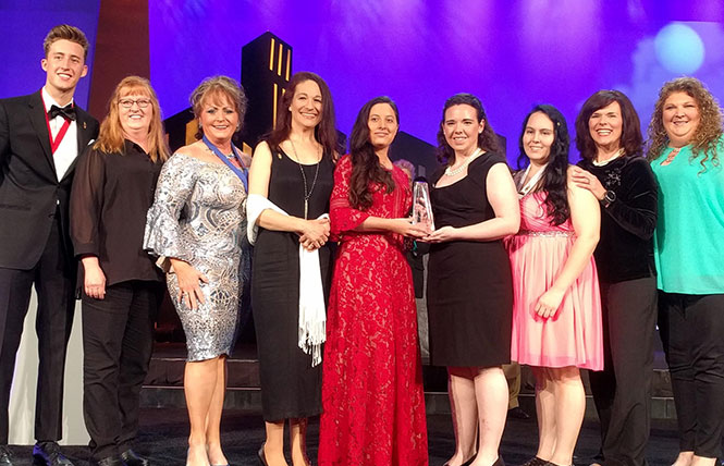 scc advisors and students receiving awards at the phi theta kappa international conference award ceremony