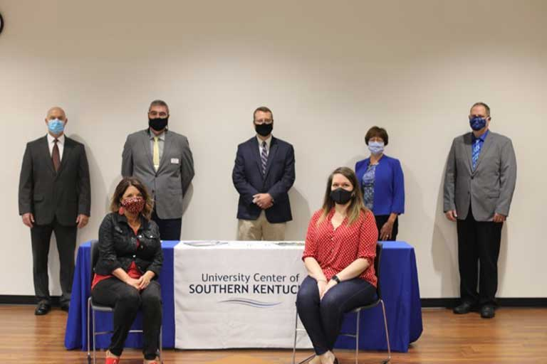 College officials signed an agreement with the University Center of Southern Kentucky that will allow students to attend SCC for two years and then transfer to Lindsey Wilson College for their Bachelor's degree with an emphasis in Business through the University Center located at SCC's Somerset campus.