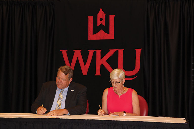 dr. castle and wku provost signing transfer agreement